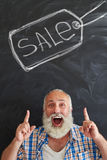 Aged stylish man inviting to note that it is sale time Royalty Free Stock Photo