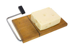 Aged Swiss cheese on cutting board Royalty Free Stock Images