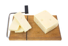 Aged Swiss cheese with slices on cutting board Royalty Free Stock Photos