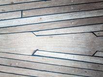 Aged teak deck. Aged ships deck in teak with black caulking Stock Photo