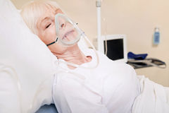 Aged tender lady having problems with her lungs Royalty Free Stock Image