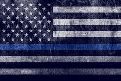 Aged Textured Police Support Flag Background. An aged textured law enforcement support flag with a thin blue line Stock Photos