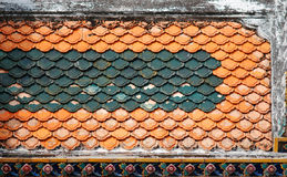 Aged tiles on temple Royalty Free Stock Images