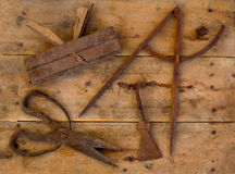 Aged tools wood planer wool scissors drawing compass Royalty Free Stock Photography