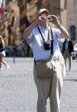 Aged tourists taking a photo with digital camera Royalty Free Stock Photo