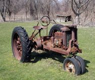 Aged Tractor. A old aged vintage tractor stock photography
