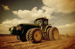 Aged tractor at field. Tractor working at the  field Stock Photos