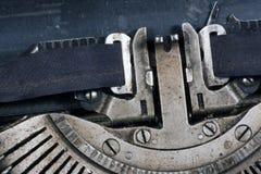 Aged typewriter. Aged mechanical typewriter - detail of the writing head Stock Photos