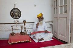Aged typical Indian Man smoking Stock Image