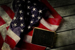 Aged USA flag and book. Stock Images