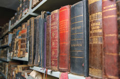 Aged, very old book on focus and blur. Aged old book in, monastery museum library blur, background Stock Photos