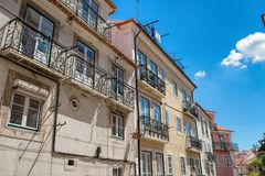 Aged vintage building facade with balcony. Vintage building faca Royalty Free Stock Photo
