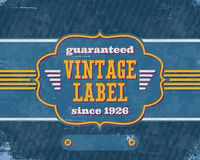 Aged vintage labelon blue cardboard Stock Photo