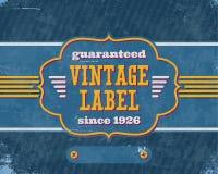 Aged vintage labelon blue cardboard Stock Photo