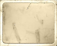 Aged Vintage Paper. An antique, old, vintage, brittle and cracked light brown paper cardboard, and patched with tape Royalty Free Stock Photo