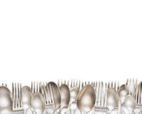 Aged vintage silver forks and spoons border isolated Stock Images
