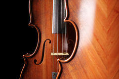 Aged violin close-up on black background. 3d rendering Royalty Free Stock Image