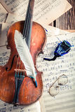 Aged violin and sheets Royalty Free Stock Images