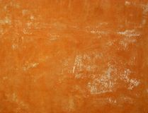 Aged Wall. Detail of Ancient destroyed cracked orange front facade royalty free stock images