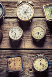 Aged wall with clocks. Closeup of aged wall with clocks royalty free stock image