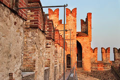 Aged wall and tower of medieval castle Stock Image