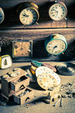 Aged watchmaker's room with clocks to repair. Closeup of aged watchmaker's room with clocks to repair royalty free stock photos