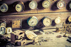 Aged watchmaker's room full of clocks. Closeup of aged watchmaker's room full of clocks royalty free stock photography