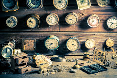 Aged watchmaker's room with many clocks. Closeup of aged watchmaker's room with many clocks stock images