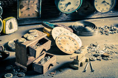 Aged watchmaker's room with parts of clocks. Closeup of aged watchmaker's room with parts of clocks stock photography