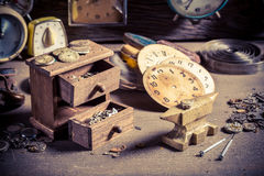 Aged watchmaker's workshop full of clocks. Closeup of aged watchmaker's workshop full of clocks royalty free stock photo