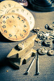 Aged watchmaker's workshop with many clocks. Closeup of aged watchmaker's workshop with many clocks stock photography