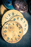 Aged watchmaker's workshop with parts of clocks. Closeup of aged watchmaker's workshop with parts of clocks royalty free stock photo