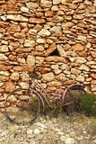 Aged weathered bicycle vintage stone wall Royalty Free Stock Photography