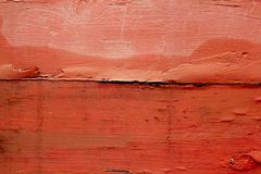 Aged weathered wood painted in red orange color Royalty Free Stock Image
