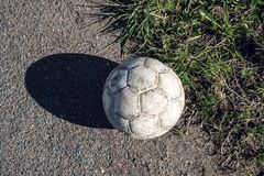 Aged white soccer ball royalty free stock photography