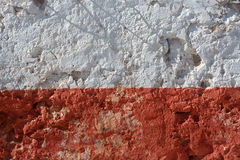 Aged whitewashed wall with red grunge paint Stock Photo