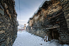 Aged winter alley in Ushguli Royalty Free Stock Photo