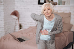 Aged woman with bad backache Stock Images