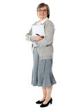 Aged woman carrying business documents Stock Images