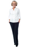 Aged woman in corporate attire. Attractive senior lady in business attire Royalty Free Stock Photography