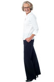 Aged woman in corporate attire. Beautiful senior lady in business attire Stock Photo
