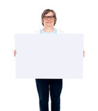 Aged woman displaying blank poster Stock Photos