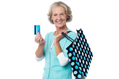 Aged woman displaying her cash card Royalty Free Stock Photo
