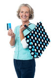 Aged woman displaying her cash card Stock Photography