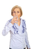 Aged woman drinking water Stock Images