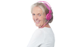 Aged woman enjoying today's music Royalty Free Stock Photo