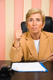 Aged woman give thumb up Royalty Free Stock Photo