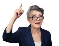 Aged woman pointing her finger upwards Royalty Free Stock Photos