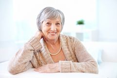 Aged woman. Portrait of aged female looking at camera with smile Stock Photography