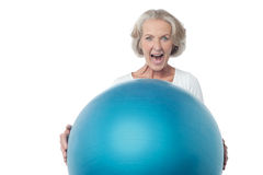Aged woman posing with exercise ball Stock Photo